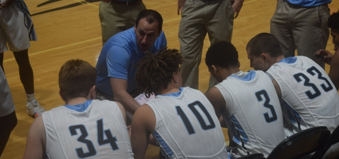 Collins coach Chris Gaither talks with his team during its 30th District tournament win over Shelby County on Feb. 18.