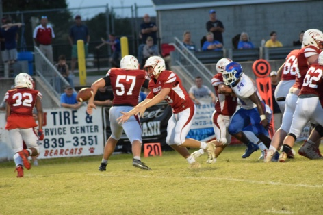Anderson County quarterback Jagger Gillis pitches to a running back.