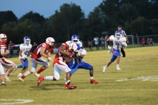 Kynan Russell tries to evade a Madison Central tackler.