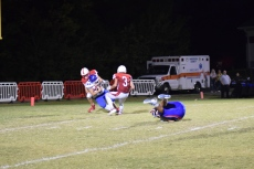 Anderson County's Jakob Redman makes a tackle for a safety as Sam Harrod looks on.