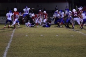 Madison Central's Daeshon Gowdy (49) goes airborne as Zach Labhart goes low for yardage.