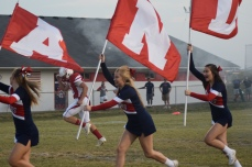 Anderson cheerleaders lead the Bearcats onto the field.