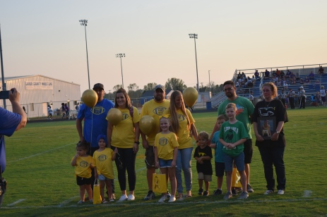 Before the game, LaRue County honored members of the community who had been affected by childhood cancer.