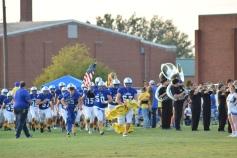 Senior Tucker Shelton leads LaRue to the field.