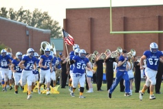 Senior Dalton Underwood carries the American flag to the field.