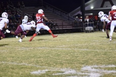 Kynan Russell tries to break a tackle.