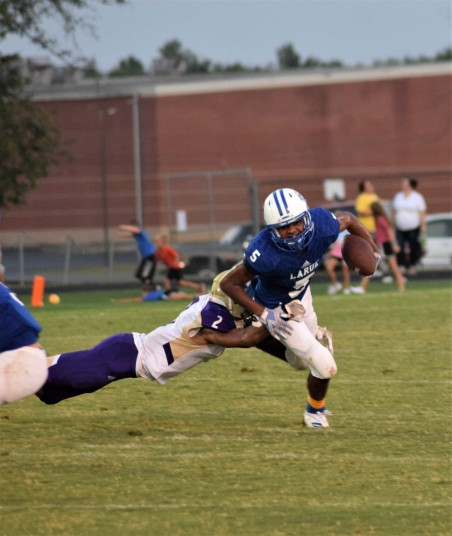LaRue County's Tyrell Coulter breaks a tackle.