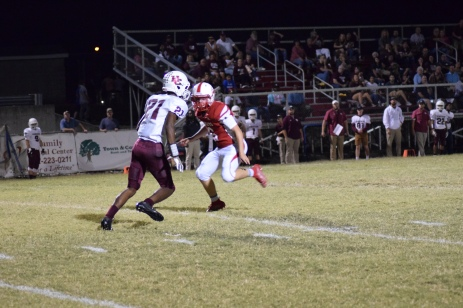 Henderson's Myekel Sanners takes the second half kickoff.