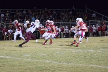 Henderson County's Myekel Sanners on the second half kickoff.
