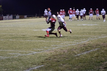 Anderson's Kynan Russell hauls in a pass.