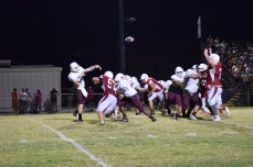 Henderson County's Sam Elliott tries to hit a receiver.