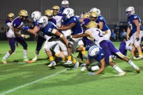 LaRue's Tyrell Coulter follows the blocking of Thomas Boone on the way to a touchdown.