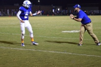 LaRue County coach Josh Jaggers gives a play to quarterback Connor Baker.