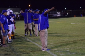 LaRue Coach Josh Jaggers celebrates with his assistants as the clock winds down in the final seconds.